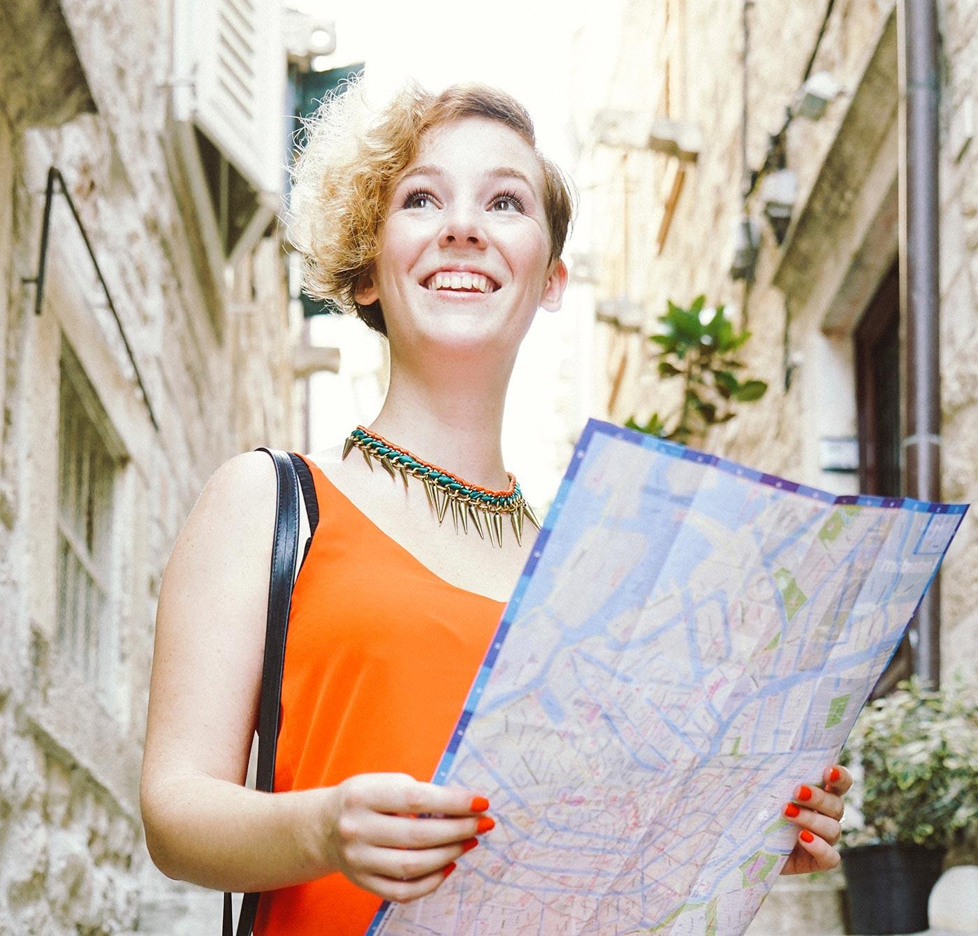 Tourist-Woman-Holding-A-City-Map-000075304727_Double