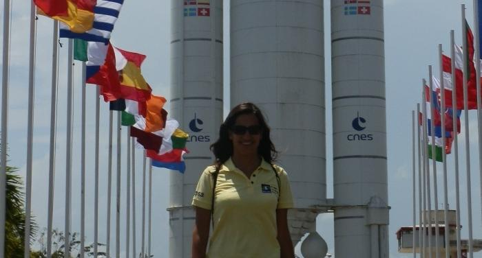 Valentini Aristotelous '03 in front of an Ariane rocket in Kourou, French Guiana during a launch campaign.